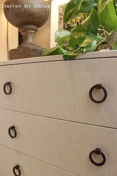 IKEA Hack: Fabric Covered TRYSIL Chest -  THIS LOOKS GREAT - IKEA hack by covering the chest with fabric (a Target tablecloth actually!) and switching out the drawer pulls.