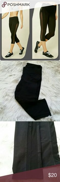 Forever 21 black sheer panel crop leggings sz Lg Forever 21 black sheer leggings  Excellent used condition! No holes, stains or wash wear.   * black stretch leggings * sheer see through side panel on both legs * cropped length (I'm 5'3 and they hit my calfs)  I love offers! Feel free to negotiate price through the offer button. Forever 21 Pants Leggings