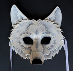 The White Wolf mask was created from a combination of 8 ounce vegetable tanned leather, and liquitex acrylic paint. It is sealed with liquitex matte varnish, which can withstand anything from sweat to rain (though heavy water exposure is not recommended).
