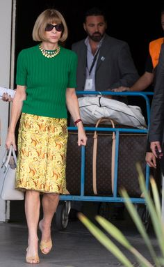 Fresh from Paris Fashion Week, Anna Wintour jet to Venice on Sept. 26, 2014 to join in the wedding celebration. The fashionista looks perfectly put together as usual, donning a green top and embroidered yellow skirt as she left the airport to board a water taxi.