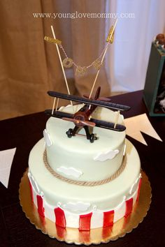 Beautiful Do it yourself Vintage Airplane party, complete with a cake banner…DIY cake banner, birthday party airplane