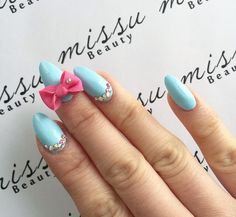 oval blue nails with crystal and now design
