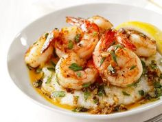 Lemon-Garlic Shrimp and Grits. Leave out the cheese...ngredients 3/4 cup instant grits Kosher salt and freshly ground black pepper 1/4 cup grated parmesan cheese 3 tablespoons unsalted butter 1 1/4 pounds medium shrimp, peeled and deveined, tails intact 2 large cloves garlic, minced Pinch of cayenne pepper (optional) Juice of 1/2 lemon, plus wedges for serving 2 tablespoons roughly chopped fresh parsley