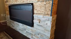 Ledgestone fireplace and TV wall