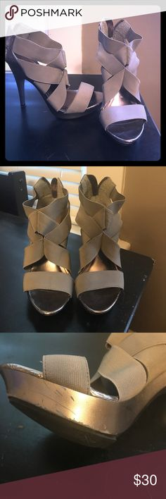 Silver and gray Aldo heels Material is gray and sole/heel is a shiny silver! The top is elastic feeling and super comfortable. Aldo Shoes Heels