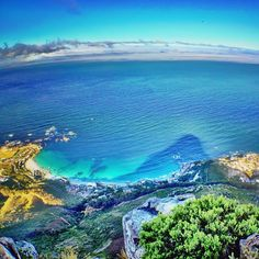 Shadow of Lions Head, cast onto the sea off Clifton Beach! #CapeTown