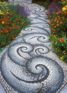 Mosaic in the garden avenue Wave pattern gray, white and blue