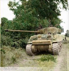A British Sherman VC 'Firefly' (Medium Tank, M4A4) of 'C' Squadron,The Staffordshire Yeomanry, 27th Armoured Brigade in the vicinity of Lebisey Wood, north of Caen, Normandy. 7th -13th of June 1944.