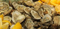 Fresh raw oysters- I like them with lemon and tabasco sauce, but the possibilities are endless!