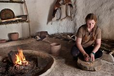 English Heritage volunteer Wendy Pallesen at work in one of the Neolithic houses