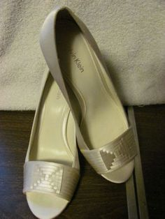 'Calvin Klein Leather Peep Toe Faux Satin Heels' is going up for auction at 11am Fri, Apr 5 with a starting bid of $16.