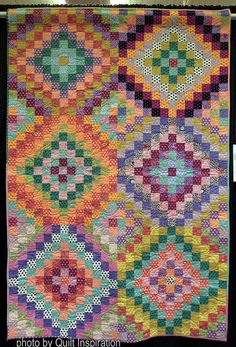 Southwest Squares, 52 x 78, by Daryl Lynn, quilted by Laura Jansen.  Pattern from Heritage Quilts by Kaffe Fassett.