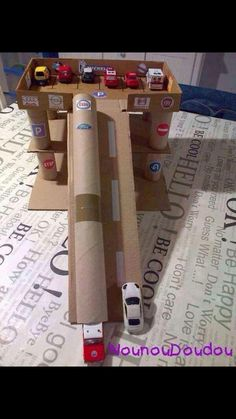 DIY cardboard garage toy for kids to make with box and cardboard tube, paper rolls