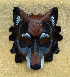 Newest color version of my newest wolf mask design; Black Dire Wolf. All wolves come in a variety of shades and colors. As in nature, no two Dire Wolf masks will ever be exactly the same. This one ...