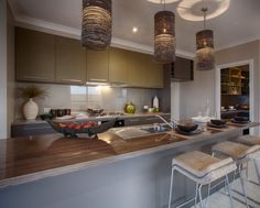 A great mix of neutral colours in this kitchen. Particularly love the pendant lights!