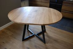 An extendable round table. Handmade to order. A 32mm thick oak (or other wood species) top on steel legs powder coated to any RAL coulour you like. Perfect table for small spaces, extendable when needed. All sizes available - you can choose the diameter of the top as well as the dimensions of the extension piece. The shape of the legs can also be slightly modified. A hardwax oil finish.