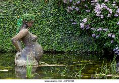 Statue of pregnant woman in Golden Channel, Trebon, Czech Republic - Stock Image