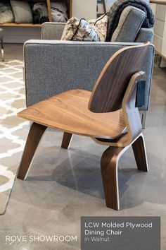 Rove Concepts Eames molded plywood chair uses a special process to curve and bend the plywood and veneers to achive no corners. The wood veneer comes in walnut stain, natural oak, and an ebony.