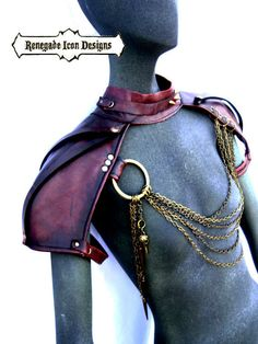 Part necklace, choker, part epaulettes, part armor....These leather epaulettes are built with an oxblood brown leather and accented with antique