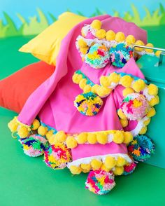 """Still pretty madly in love with this pom pom blanket/towel we made for summer picnics and beach trips! Perfect for Memorial Day festivities this weekend!  (Search """"Pom Pom"""" on the blog for the tutorial!  by @jeffmindell) by studiodiy"""
