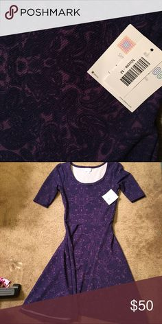 NWT Medium Nicole navy & purple Brand new never worn! A friend bought it and tried it on. Beautiful navy blue and purple colors. Smoke-free and pet-free home. LuLaRoe Dresses Midi
