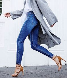 Blue skinny jeans, white blouse, grey jacket, brown strappy heels.