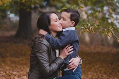 An intimate and natural photograph of a son hugging his mother during a lifestyle family photo session at the Arnold Arboretum in Boston, Massachusetts