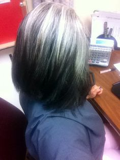 Growing out your dyed hair and welcoming the grey w low and hi lights. Softens the transition.