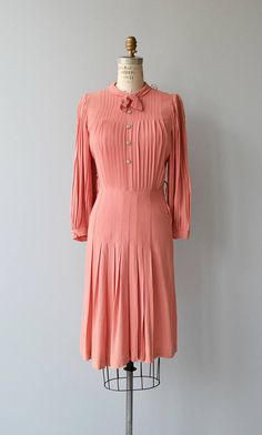 Vintage 1940s coral rayon dress with pleated bodice, long pleated bishop sleeves, bow collar, fitted waist, belt loops but no belt present and metal side zipper. --- M E A S U R E M E N T S ---  fits like: small bust: 37 waist: 26 hip: 35.5 length: 41 brand/maker: n/a condition: excellent  to ensure a good fit, please read the sizing guide: http://www.etsy.com/shop/DearGolden/policy  ✩ layaway is available for this item  ✩ more vintage dresses ✩ http:/&...