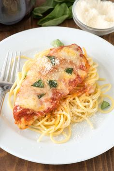 Easy Chicken Parmesan - this quick dinner recipe is totally foolproof. The chicken comes out moist every time! It's the BEST chicken parmesan recipe.