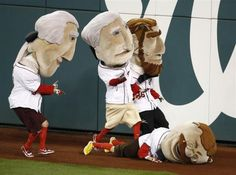 The Theodore Roosevelt mascot falls to the ground during the Presidents Race in Game 5 of the NLDS  series between the St. Louis Cardinals and the Washington Nationsl in Washington, October 12, 2012. REUTERS-Jonathan Ernst