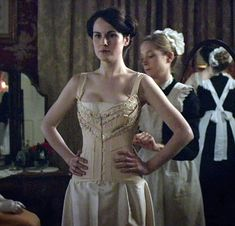 Downton Abbey's Lady Mary being squeezed into hercorset.