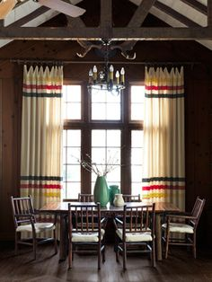 Like the color scheme in the curtains.  Reminds me of point blankets.  The Heisters stitched these striking drapes from classic Hudson's Bay blankets.    Read more: Cabin Decorating Ideas - Home Decorating Ideas - Country Living