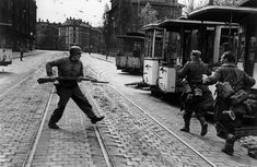 """operationbarbarossa: """" Immediately after an American soldier had been shot during a house to house fight, his comrades went down to the street to capture the German snipers that had shot him; Leipzig - 18 April 1945 """" Photo by Robert Capa """" """" Dude..."""