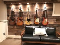 Guitar display wall. I transformed this wall and added spotlights to display my guitars.