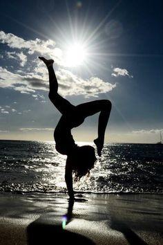 Yoga on the beach. Beautiful shot!