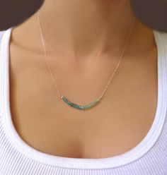 Genuine Beaded Apatite Necklace Subtle and sweet... Chain is adorned with petite and delicate slices of brilliant blue, aqua, and green apatite gemstones. The variety of colors are beautiful and femin