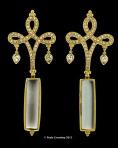 PAULA CREVOSHAY - YE2011B - You can see the strong Asian influence rooted in the design of these earrings. The swirling flowing tops are a nice contrast to the strong straight lines of the Moonstone drops. Made in 18K these earrings are part of the Chinoiserie Collection. Zircon (100)=1.69, Zircon(4)=0.0.01, Moonstone Drops(2) = 24.78ct