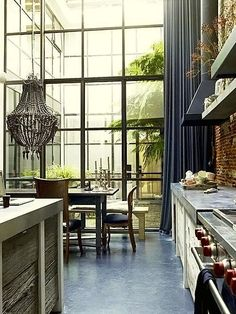 lots of windows with a gorgeous drapery, stainless counters, brick, love love love