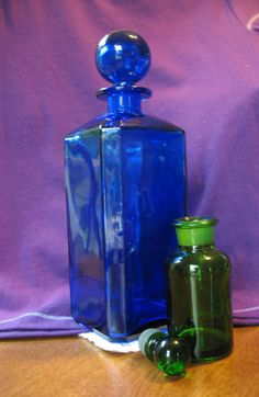 apothacary glass bottles with stoppers