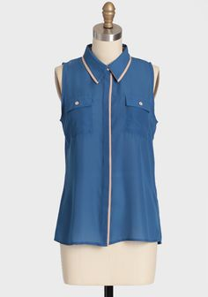 """5th Avenue Button Up Top 32.99 at shopruche.com. We can't get enough of this delicate blue chiffon top with khaki accents, front pockets, and hidden front button closures. Semi-sheer. Tuck into a high-waisted skirt or trousers for a look that is polished and sophisticated.100% Polyester, Imported, 24.5"""" length from top of shoulders, 36"""" bust, All measurements taken from a size small"""