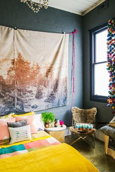 Love that gray painted brick wall. And colorful pom poms.