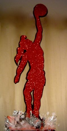 Sports poses work for any theme but here's a girly basketball pose. This one was 3 layers with red glitter on both sides.