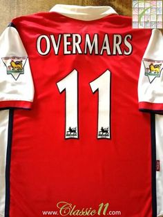 Official Nike Arsenal home football shirt from the 1998/1999 season. Complete with Overmars #11 on the back of the shirt and Premier League Champions patches on the sleeves.