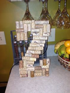 Cardboard letter from Hobby Lobby ($3.50) with wine corks hot glued on. Need to hot glue a wall hanger to the back  So excited for Mom and Dad to unwrap this on Christmas Day!!