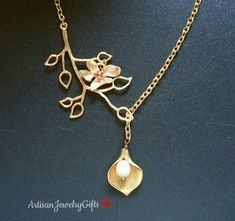 Elegant gold calla pearl branch necklace. High quality artisan jewelry from ArtisanJewelryGifts.etsy.com