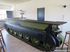 A bar crafted from a salvaged Russian military tank! This is just AWESOME!