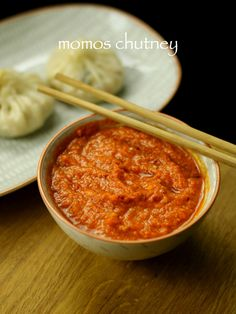 momos chutney recipe | spicy tomato garlic momos sauce with step by step photo recipe. spicy tangy chutney can be served with any indo chineese momos recipe