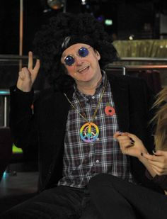 Louis Walsh dons an afro and goes hippy