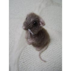 This pattern is for a life size, life like mouse. Knitted using 3mm needles with DK or equivalent yarn and brushed with a teasing or wire brush to make furry. Clear easy to follow pattern, using just knit and purl stitches. Knits up very quickly to produce a cute, life like mouse.